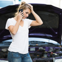Woman calling for help in front of car